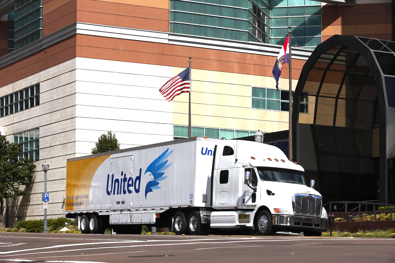 Amrazek Moving Truck Moving Through City